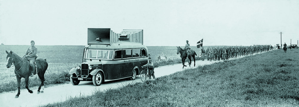 Portable audio innovation from the days of yore: a B&O mobile loudspeaker van in the early 1930s, Denmark. Experiments were made to replace the Danish regimental orchestras with this custom B&O sound system. Though an immediate novelty, it was not a longterm success.