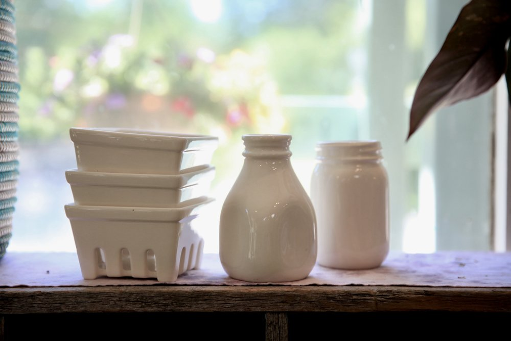 Classic milky white pottery starting $15.95. Present the baskets filled with Morning Glory Farm strawberries, pop a perfect peony into the milk bottle, or fill the mason jar with caramels.