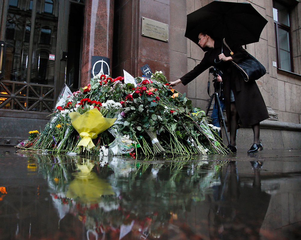 A woman lays flowers in front of the French consulate in St.Petersburg, Russia, Saturday, Nov. 14, 2015, for the victims of the Paris attacks on Friday. French President Francois Hollande said more than 120 people died Friday night in shootings at Paris cafes, suicide bombings near France's national stadium and a hostage-taking slaughter inside a concert hall.  Photo by Dmitry Lovetsky/AP
