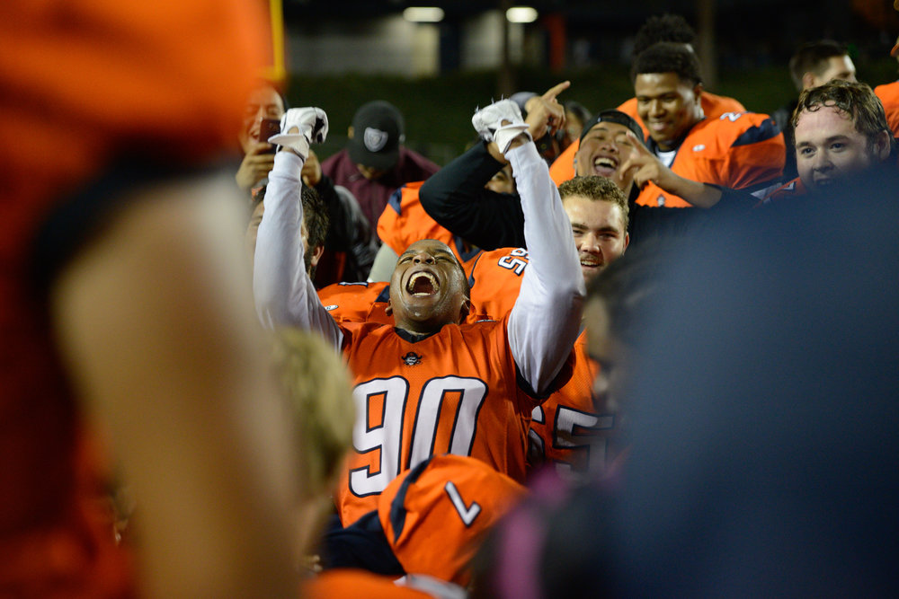 Orange Coast College defensive lineman Josh Odigie celebrates with his teammates after winning the football game against rival college Golden West on Nov. 7, 2015, in Costa Mesa, CA. The Orange County College football team won the Victory Bell for the first time since 2009.