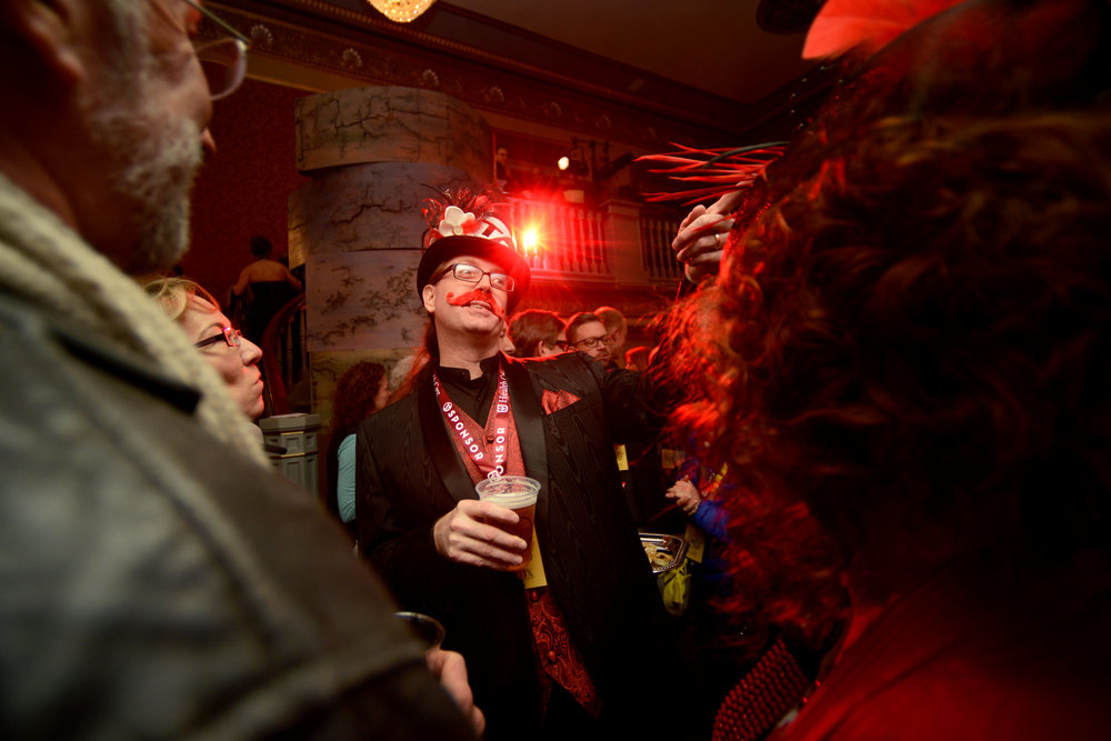 Steve Powell points to a friend during the True/False Jubilee masquerade Thursday, March 3, 2016, at the Missouri Theatre in Columbia, MO. Powell and his wife, Kristi, were sponsors of the festival and had been attending the festival for five years.