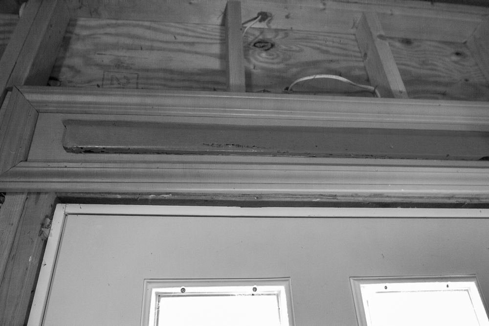 It turned out that when they replaced the front porch, they kept the old threshold board that you stepped over as you entered the house.  Another amazing gift for me.  I think I was so surprised that I didn't take a very good photograph of it.  I plan on hanging it in my next residence. We went through to the back yard, which was re-landscaped from our time there, and over to the side yard.  There, Mrs. Smith pointed out one of the trees that had been there for years and told me how it died but came back to life.  My father spent a lot of time in the back and side yards, doing landscaping.