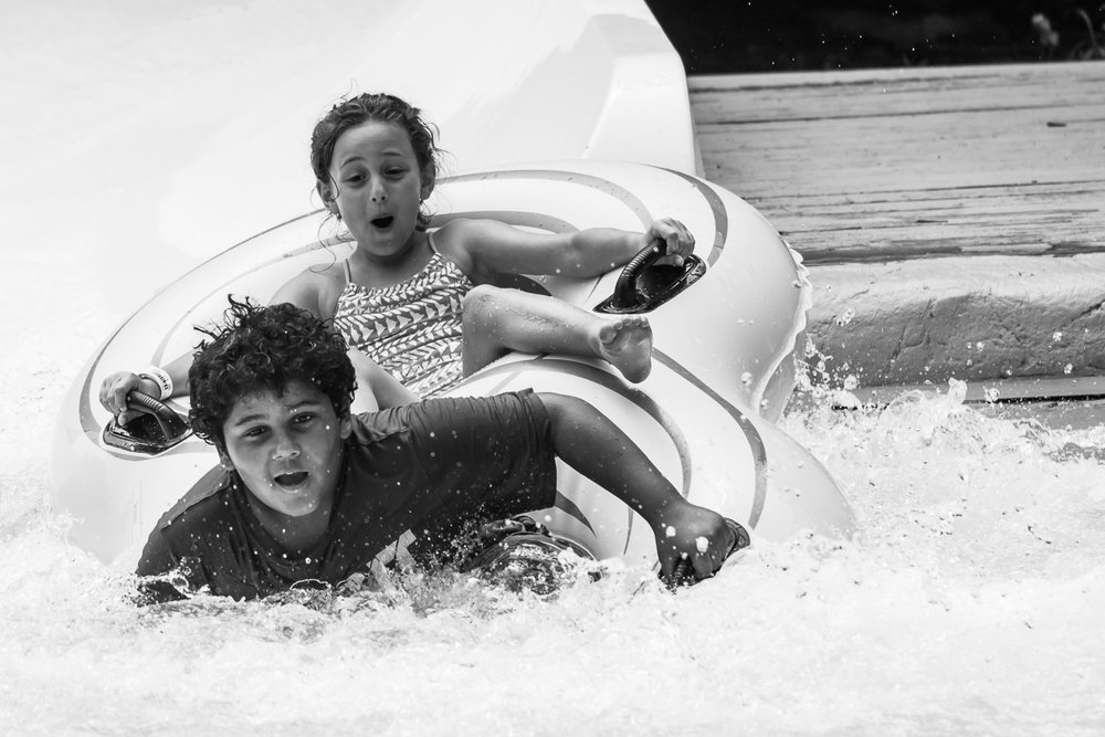New Jersey Family Photographer - Black and white photo of boy and Girl Water Tubing at Mountain Creek Water Park