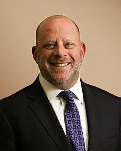 STEPHEN C. LOCKER, CFP® Chief Executive Officer