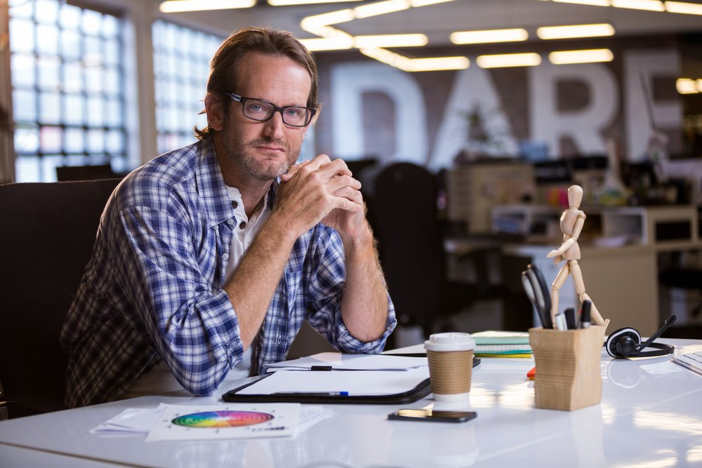 Creative businessman at desk in office
