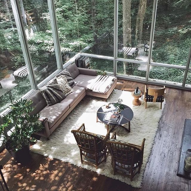 A cozy living room with the most beautiful floor to ceiling windows looking out at the surrounding forest. #wishiwasthere #interdesign #escape #middleofnowhere #ifonly