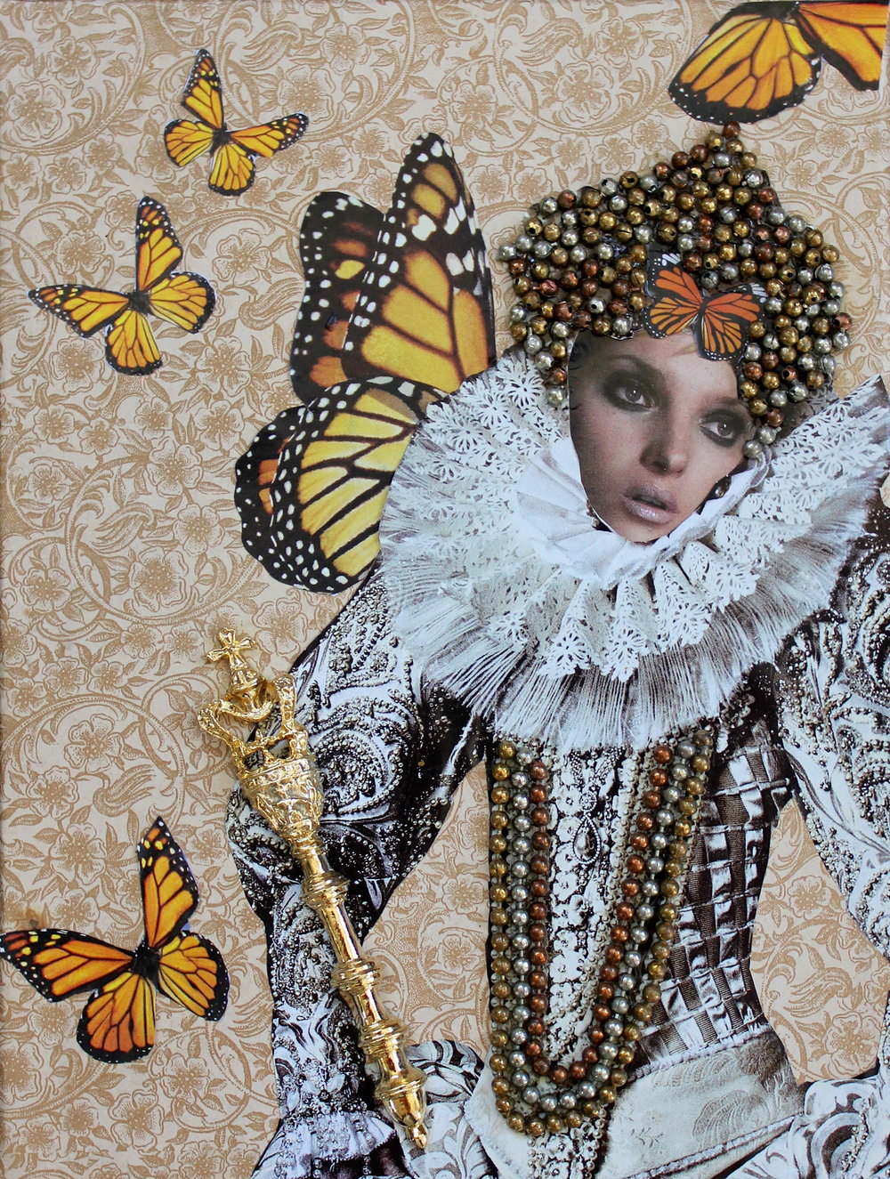 """The Butterfly Queen""  Materials used:  Paper ephemera, pin, key chain"