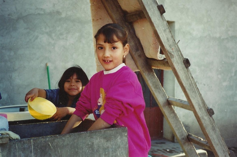 I was about 9 or 10 in this pic, washing something in   Santa Rosa, Durango, Mex.   Shout out to my cuz Daniela!