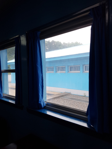 The 38th parallel is marked by that concrete slab you see through the window. This photo was taken while I was, technically, on the North Korean side of the DMZ.