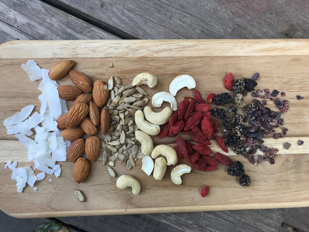 Coconut chips, almonds, sunflower seeds, cashews, goji berries, mulberries, cacao nibs
