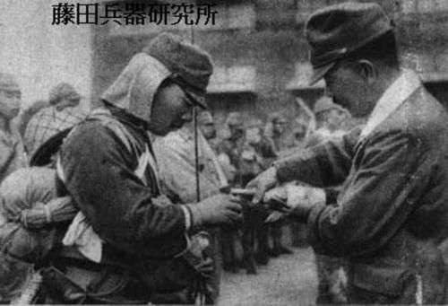 An officer giving sake to a soldier before a mission.
