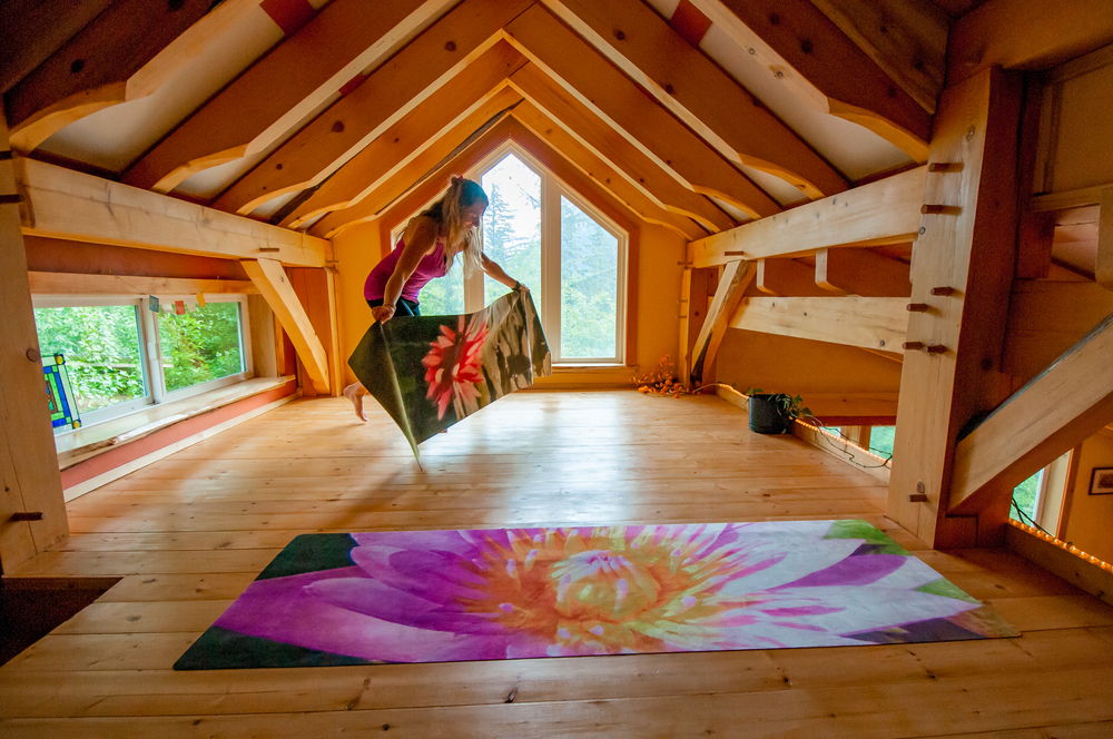 Laying out Lotus mat in loft.jpg