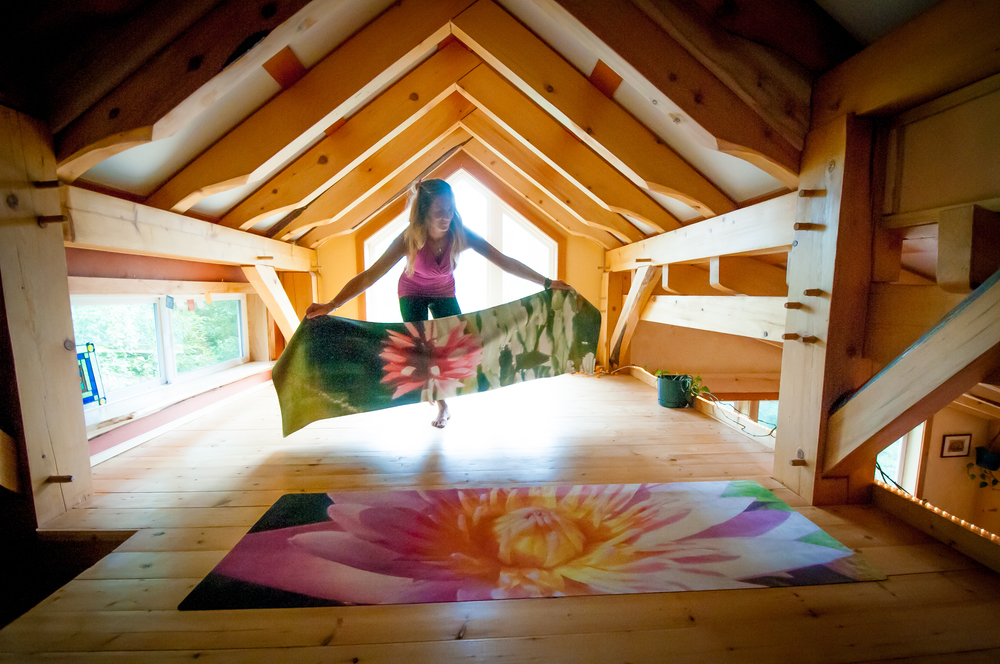 Laying out Lotus mat in loft 2.jpg