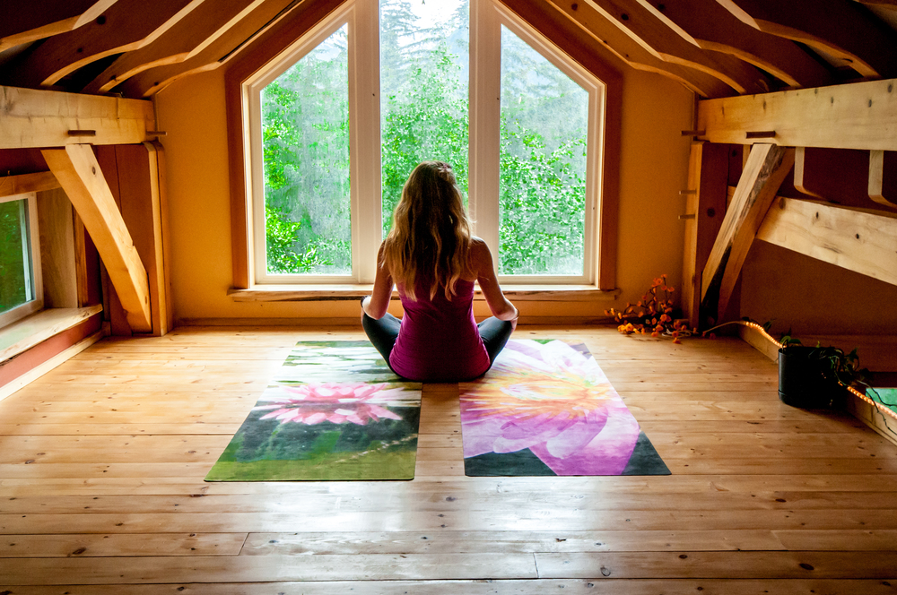 Mandy Meditate lotus mats in loft.jpg