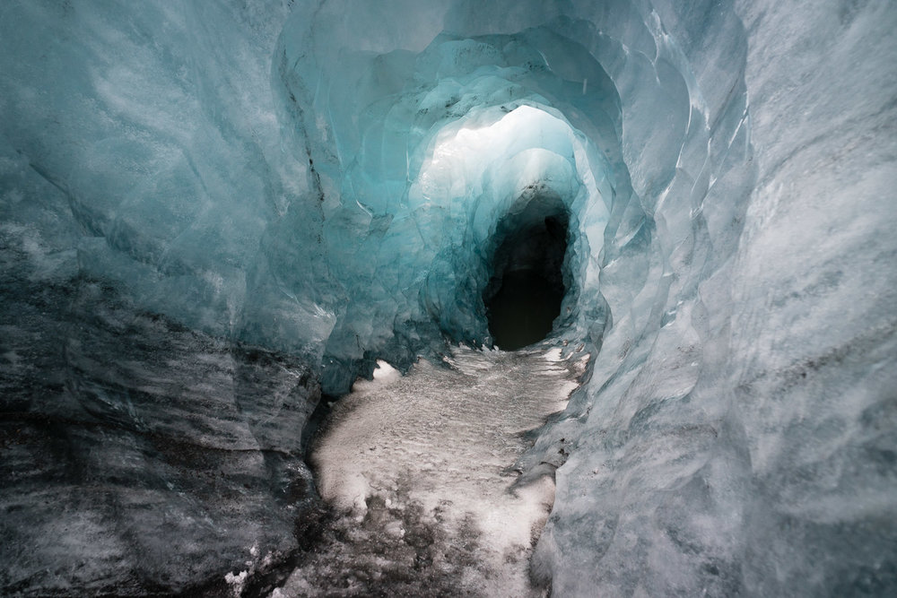 A fresh meltwater tunnel in  Sólheimajökull glacier. How deep is it and where does it go? Who knows.  95% of the world's glaciers are retreating, Iceland's no exception. Here, unseasonable meltwater bore a tunnel through solid ice in less than a week. As always for me, reading about problems like this is just a piece of the endless stream of troubling information we receive on a daily basis. Seeing it, touching it, walking in it, hearing first-hand stories about it, always puts it into a more meaningful, lasting context.
