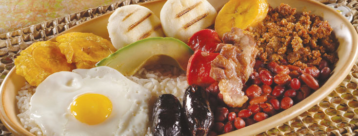 Not a picture of Ricas's Bandeja plate but this is pretty much what it looks like. Google Images.