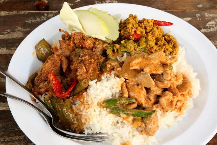 Load up a plate with Thai curries for super cheap at Khao Kang. Google Images.