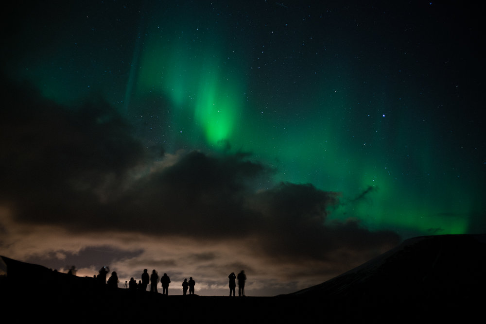 The magnificent Aurora Borealis aka the Northern Lights. Interestingly enough they appear more white to the naked eye but photograph this rich green color.