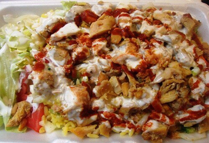 Sammy's chicken and rice. There's 2000 calories looking at ya. Looks hideous, tastes awesome. No better method for late night sopping up of booze exists in the neighbrohood. Google Images.