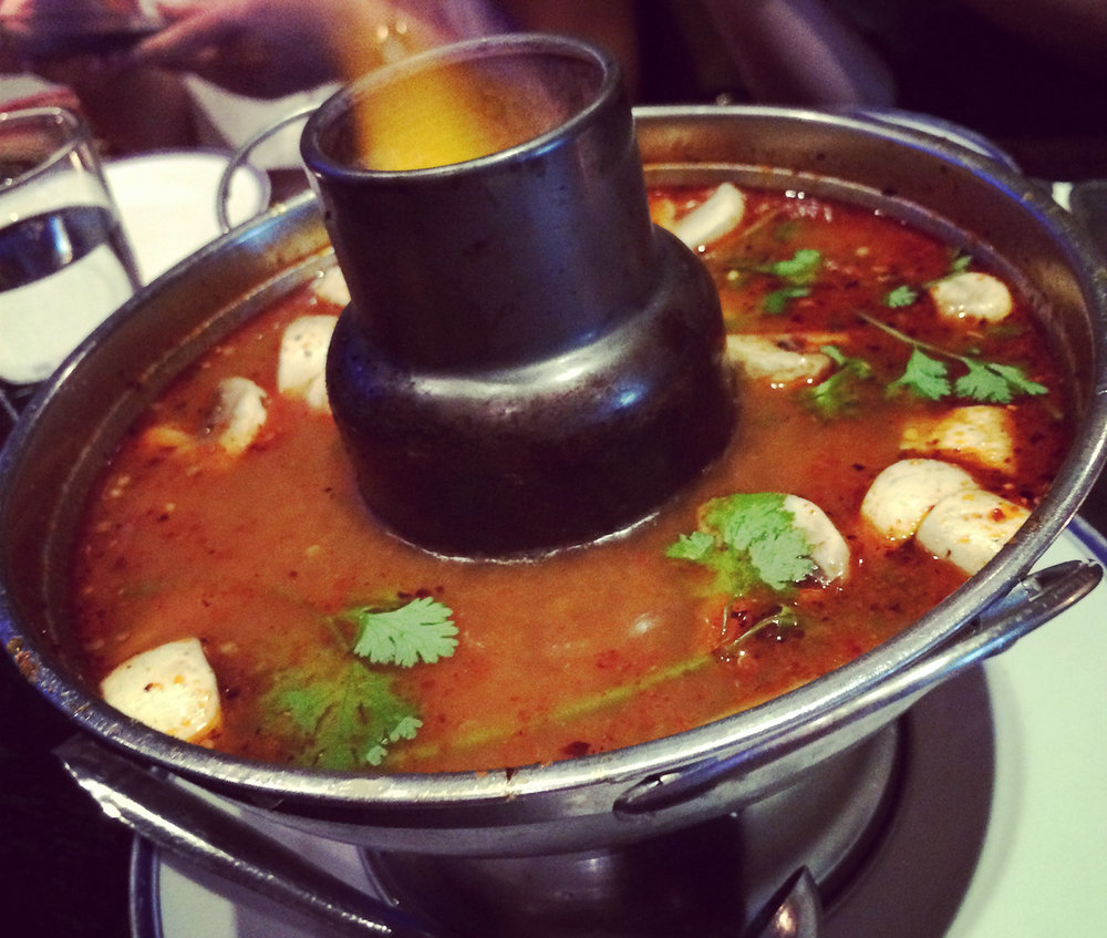 Auttharos does a lot of these delicious Thai soups in the stainless steel sterno pot. Here is a savory Tom Yum Goong (shrimp). Google Images.