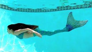 green-mermaid-in-blue-water_1.jpg