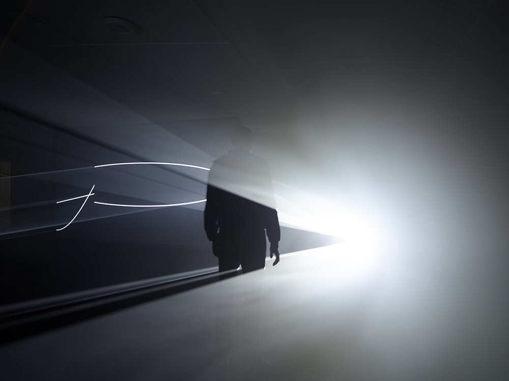 "Anthony McCall. ""Face to Face II"" (2013). Installation view, Eye Film Museum, Amsterdam, 2014. Photograph by Hans Wilschut."