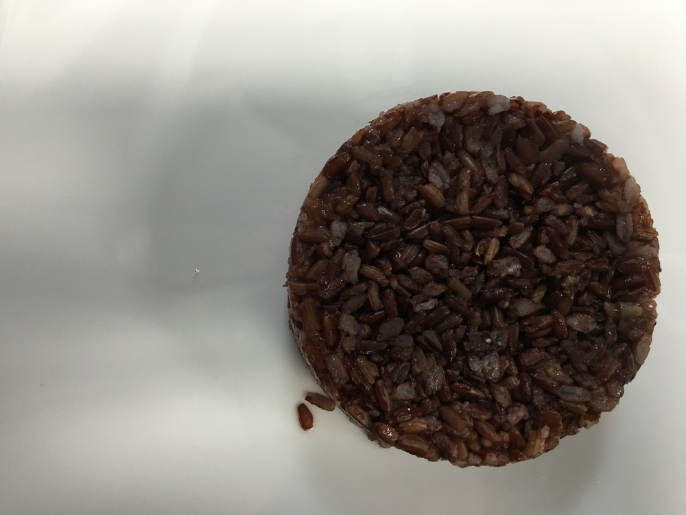 A scoop of nutty red rice