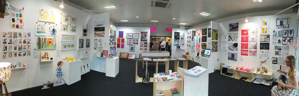 Birmingham City University booth, illustration on the left and graphics on the right.