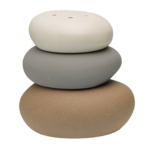 This meditative stone sculpture sets a tranquil scene with clean, neutral tones and a calming natural balance.
