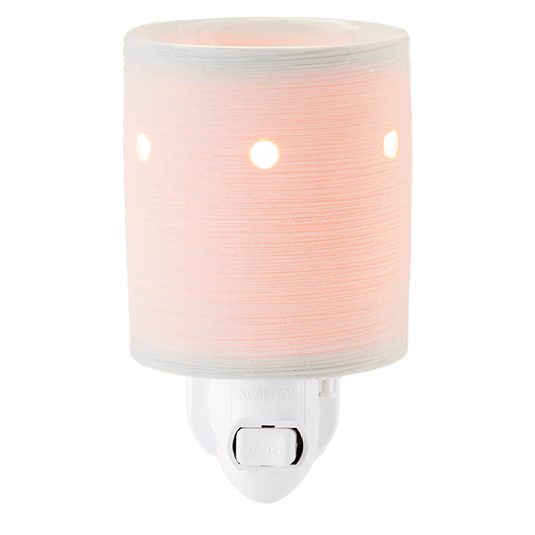 Etches in the porcelain shine through when lit, creating a uniquely textured, glowing warmer.