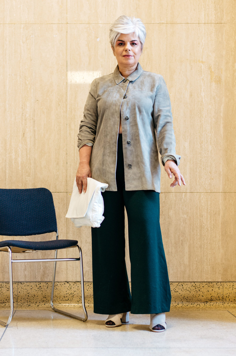 Linda holds the Five Fold clutch and wears Moss by EVA trousers.        Shirt: Designer's own.