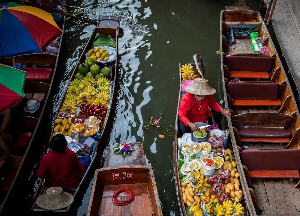 Floating Market Woman with Fruit Boat.jpg