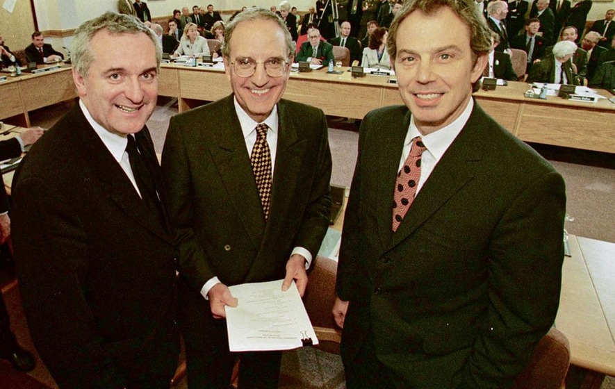Tony Blair, Senator George Mitchell and Bertie Ahern smiling after they signed the agreement // Credit: Irish News