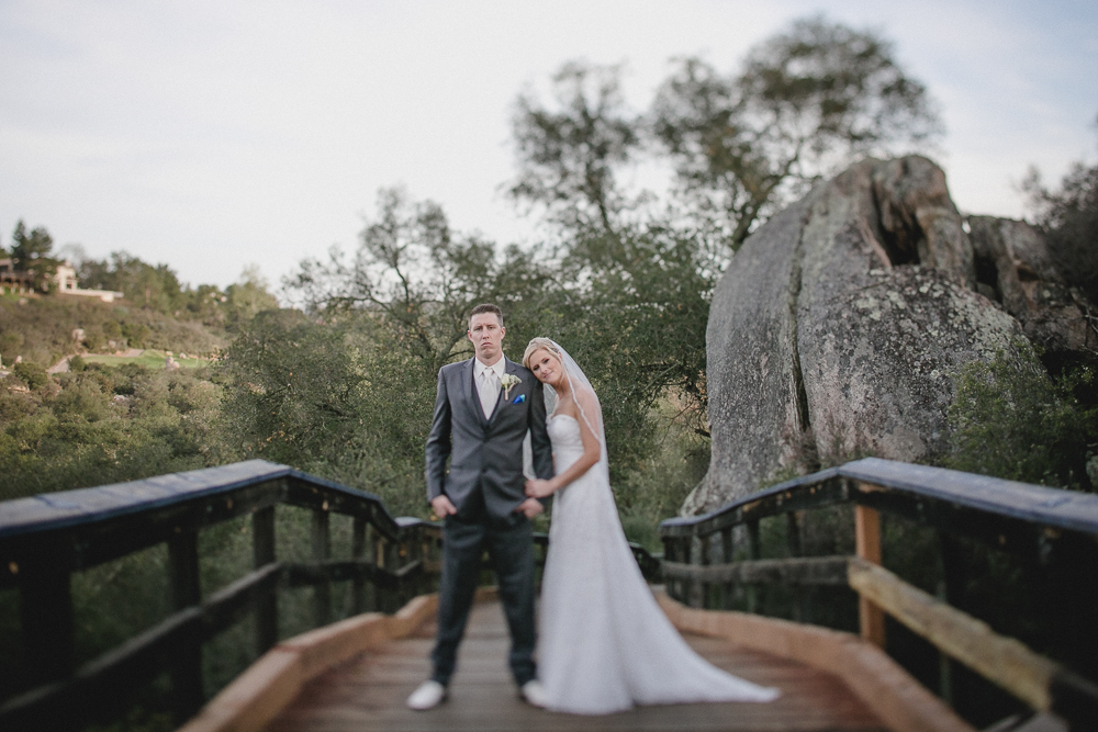 Beautiful bride and groom portrait over the golf course bridge