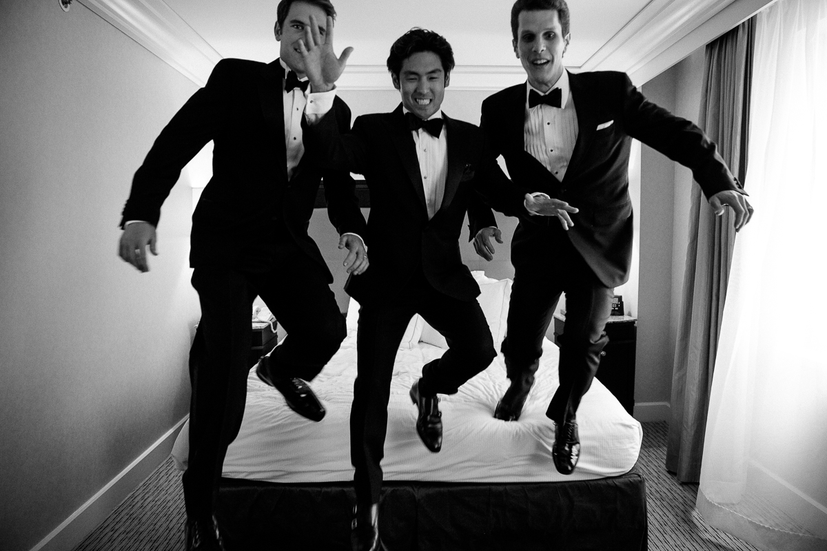 Groom and Best Men Jumping out of the bed at Loft Seven Los Angeles, wedding Photograpjy