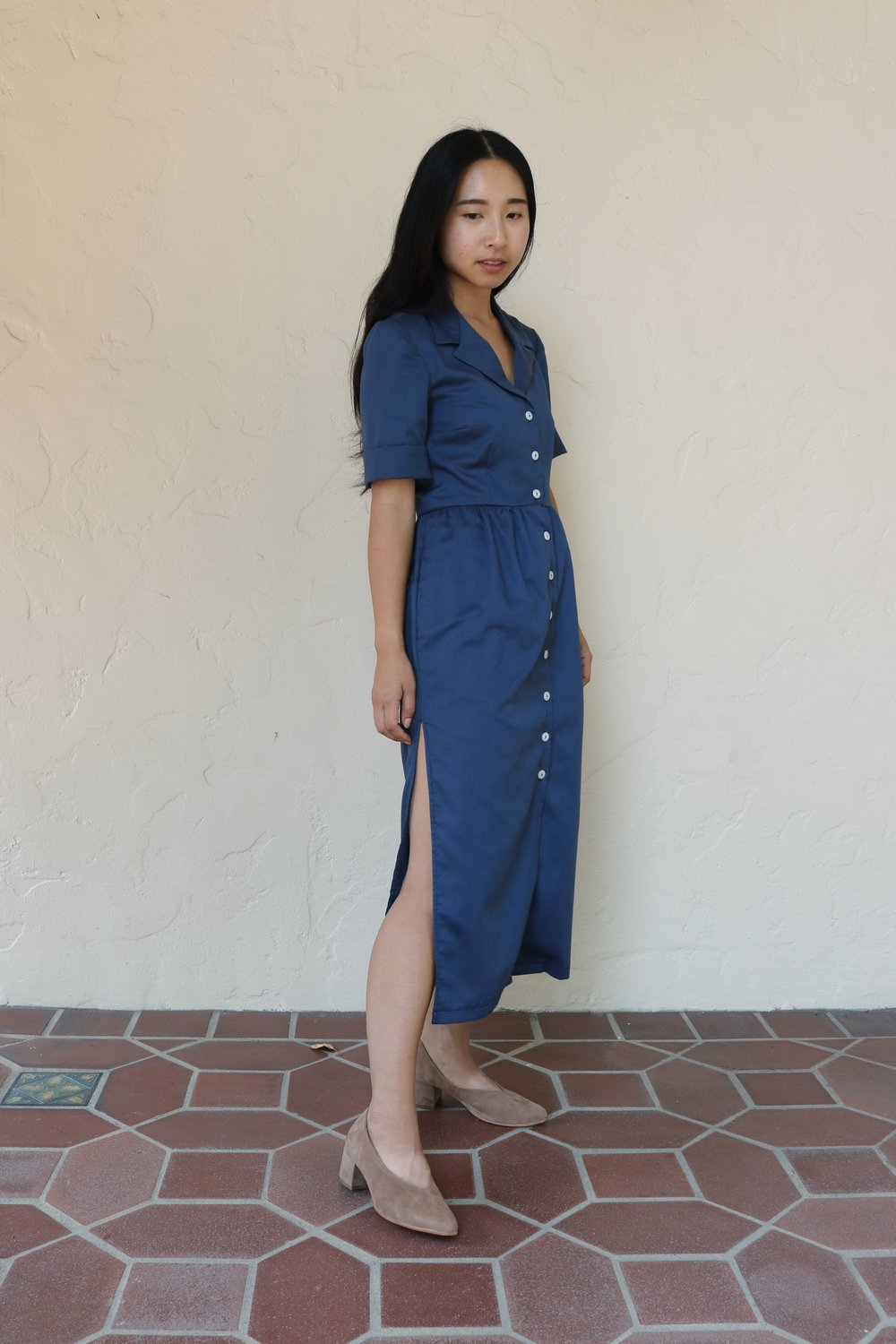 Sarina in L.A. wearing a dress of her own design with the Belu Pump