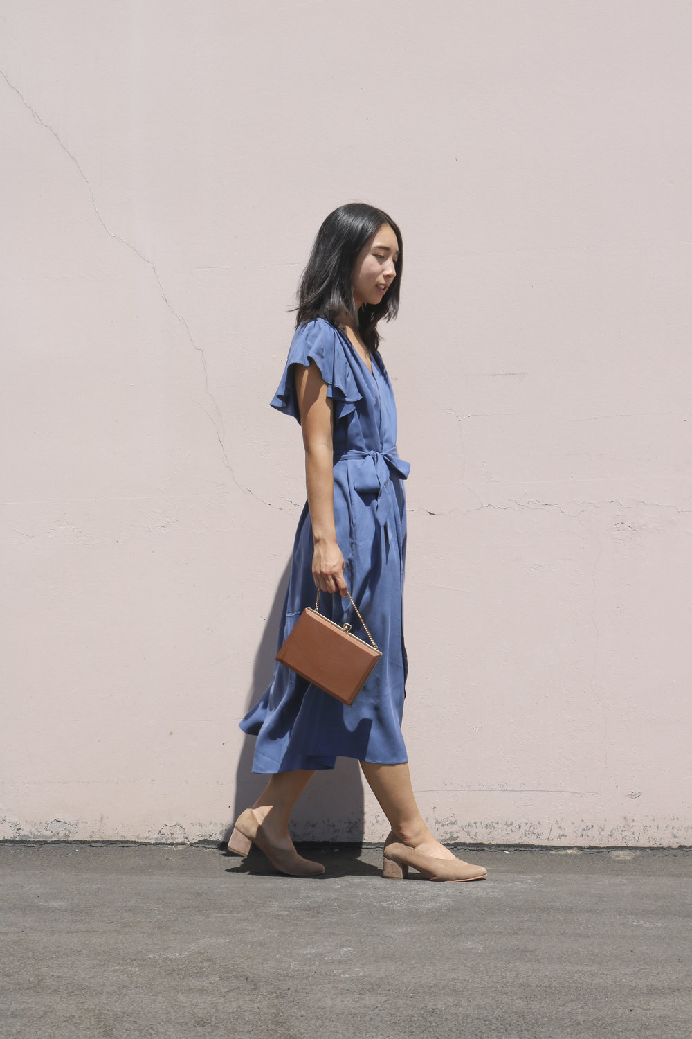 Sarina styles the Belu Pump with a wrap dress by Georgette Crimson and a vintage box purse.