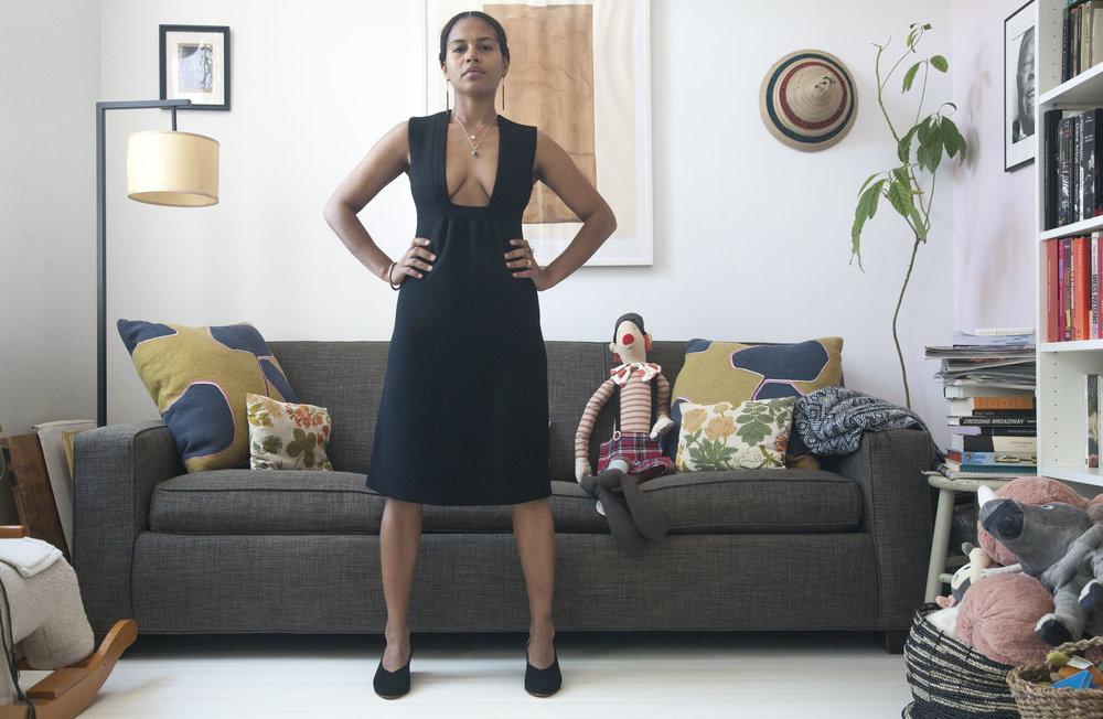 Mengly Standing in Family Room in Belu Pump.jpg