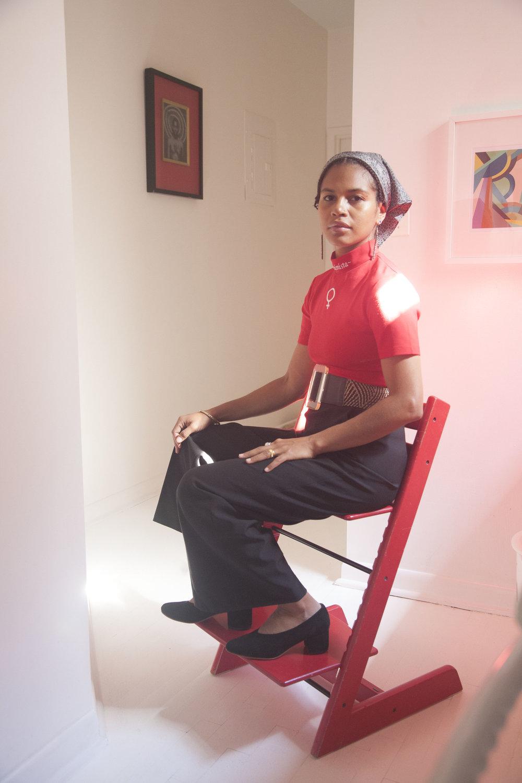 Mengly seated in Belu Pump in Red Chair.jpg