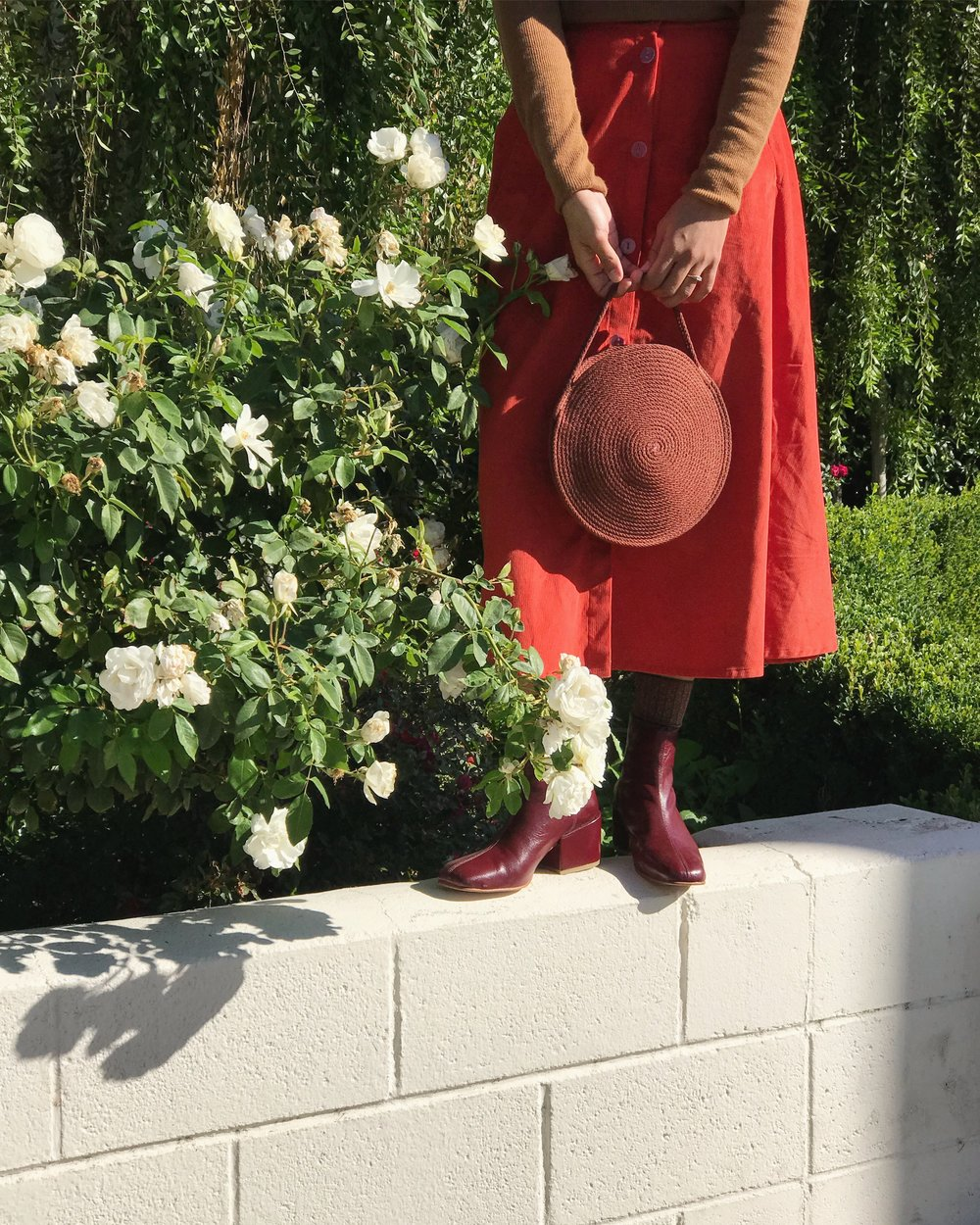 Melissa in the Mulberry Beia Boot styled with a Catzorange circle tote and the Megan Huntz Leslie Skirt