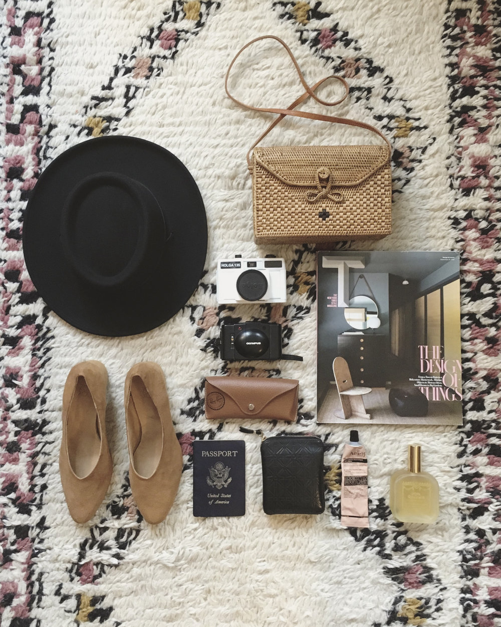 Destination: Naples, Florida - Packing Essentials: 1) Tio y Tia Gambler hat for feeling like Georgia O'Keeffe, 2) Bembien Sofia bag because it's the perfect size for all my essentials and it's woven, which makes it perfect for warm-weather adventures, 3-4) two different film cameras because in my dreams I'm a legit photographer, 5) T Magazine because it's the best way to kill time on a flight, 6) Ray-Ban sunglasses because sun, 7) Aesop hand lotion: all-in-one aromatherapy and moisturizer, 8) Santa Maria Novella perfume because it's exactly how I want to smell always, 9-10) wallet and passport (self-explanatory), and 10) last but not least Zou Xou Belu pumps (In dulce de leche suede)  because they go with absolutely everything I own.