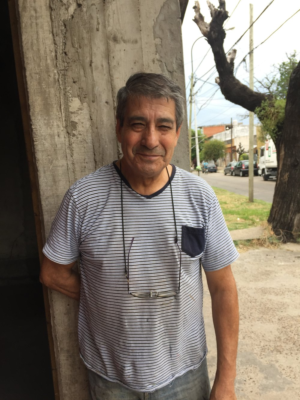 Meet Miguel  - This is the head shoemaker. Miguel was born and raised in the suburbs of Buenos Aires. He got into the shoe industry a kid, first running errands at a factory, then working his way up to becoming a shoemaker as a young man. He currently makes the majority of Zou Xou shoes out of his workshop which is about ten steps from his house in Ciudadela, Buenos Aires. Sometimes he makes the shoes from start finish, except for the stitching. When there is too much work for him to handle on his own, he calls a cutter and another shoemaker to help. He is a wiz at constructing the mules, but his favorite operation is polishing the rough edges of the soles on the sanding machine. He loves old-school Santana, goes out dancing every Saturday night without fail and just bought his first car--a shiny black Peugeot hatchback.