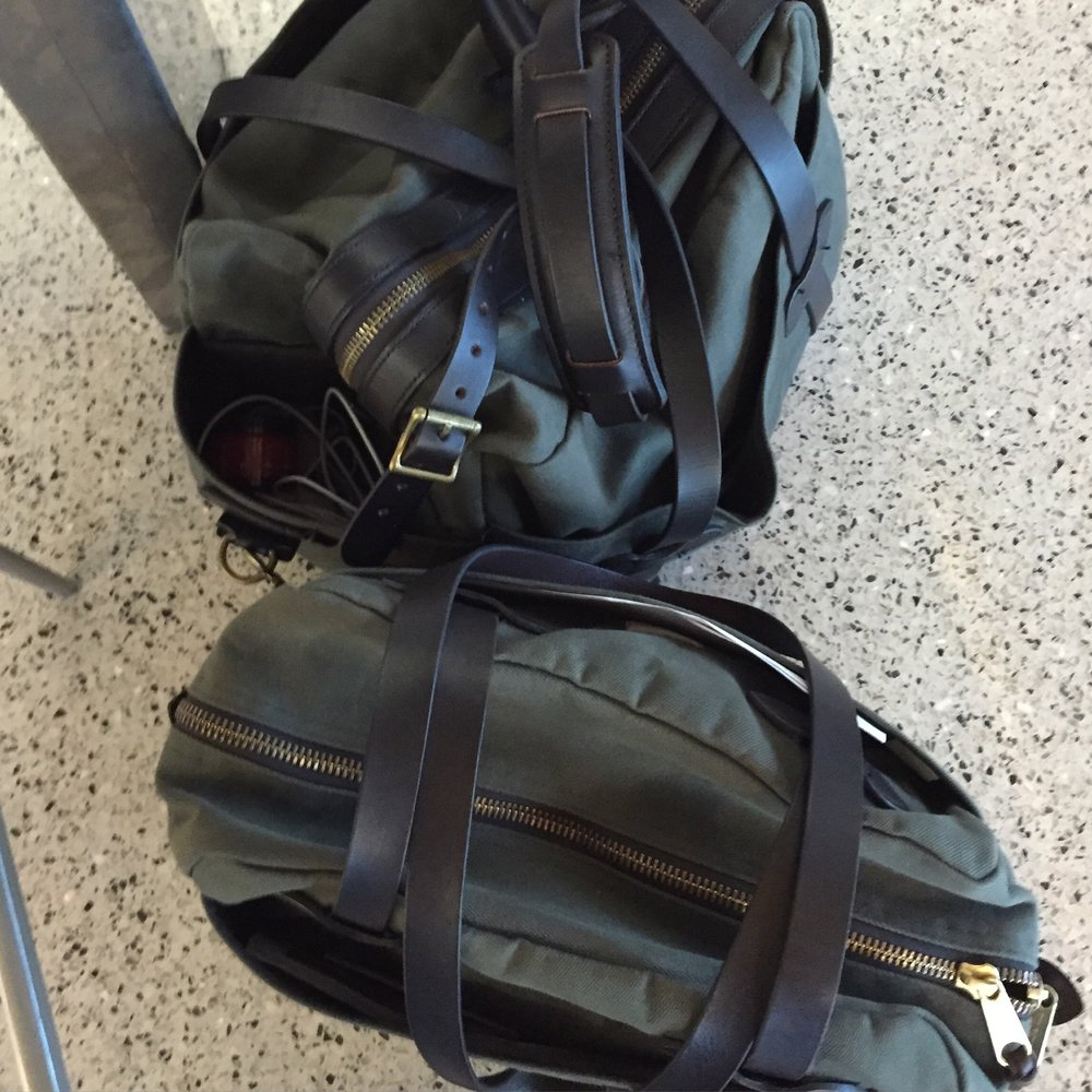 His  and  hers  carry on bags by  Filson.  His is sold out, but I linked to a similar one.