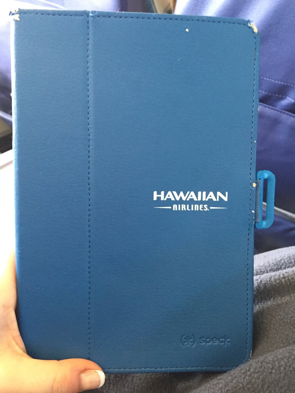 In-flight entertainment iPad Mini from Hawaiian Airlines. The case showed some wear, but the iPad functioned perfectly.