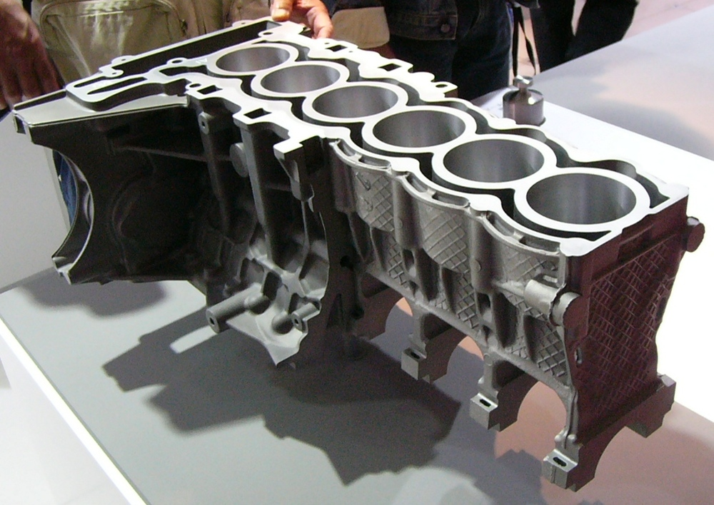 An engine block with aluminum and magnesium die castings. Image courtesy of Wikipedia, published under CC BY-SA 3.0.