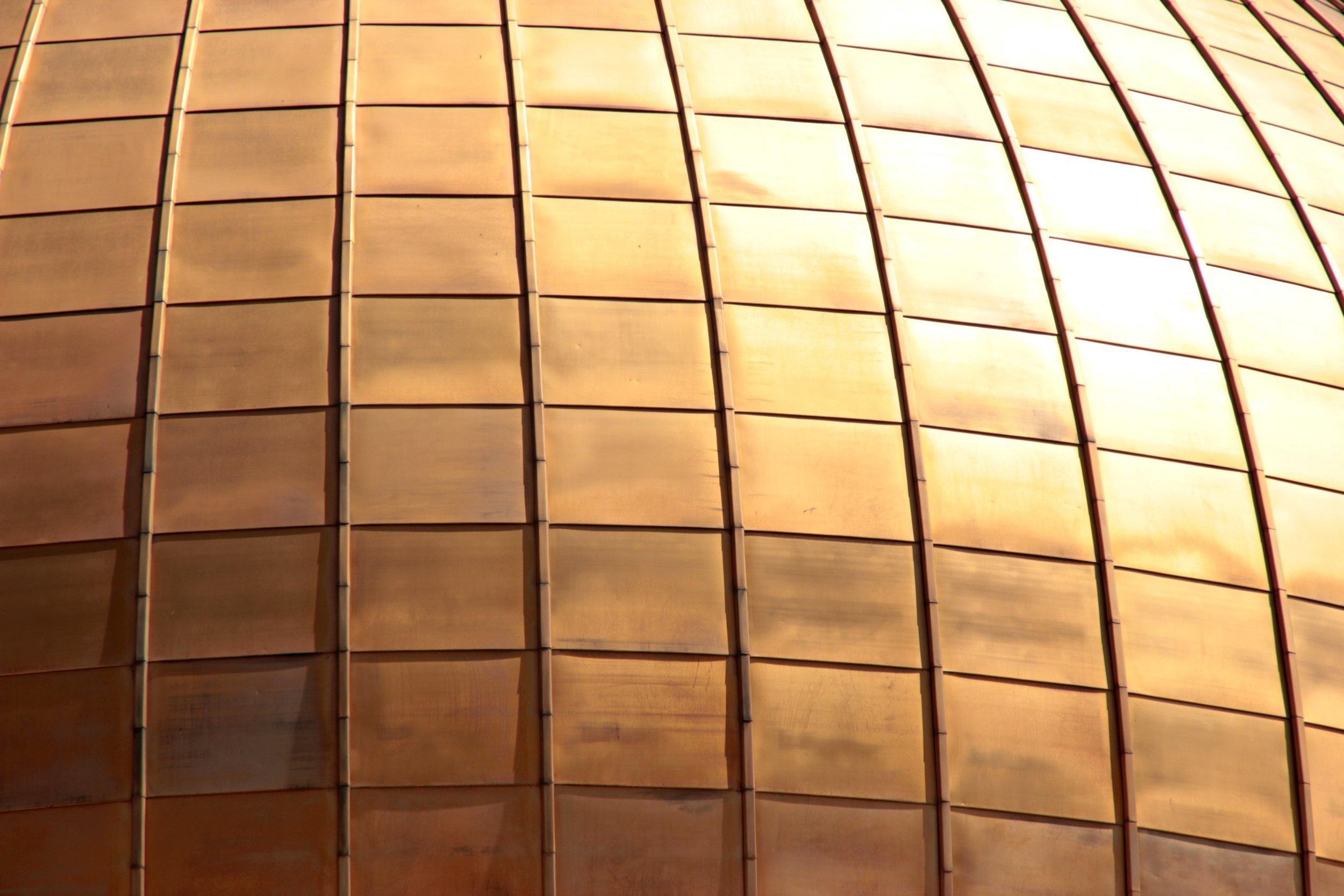 Bronze squares. Image c/o Unsplash / 9096 on Pixabay, published under  CC0 1.0 .