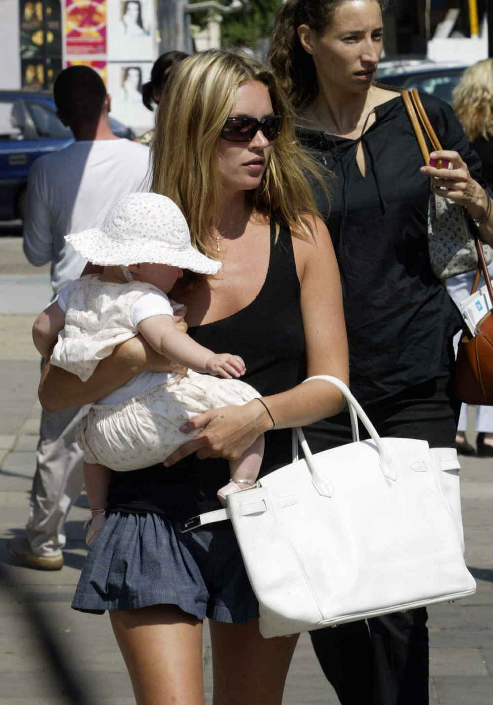 Model Kate Moss walks with her daughter Lola and a Birkin bag in 2003. Photo: Aura/Getty Images