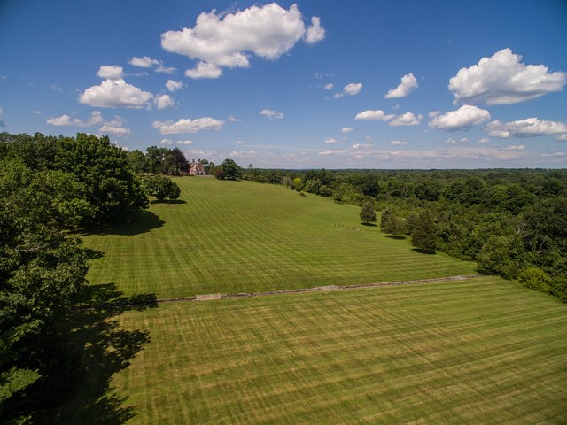The property's majestic rolling lawns are breathtaking.
