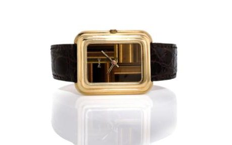 Rectangular Piaget wristwatch in 18-carat yellow gold with a tiger's eye dial from the 1970s;Credit: Artcurial