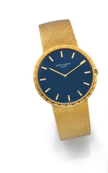 18-carat yellow gold manual winding wristwatch with a blue dial and Patek Philippe's Calatrava cross; Credit: Artcurial